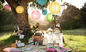 picnic under tree with lanterns